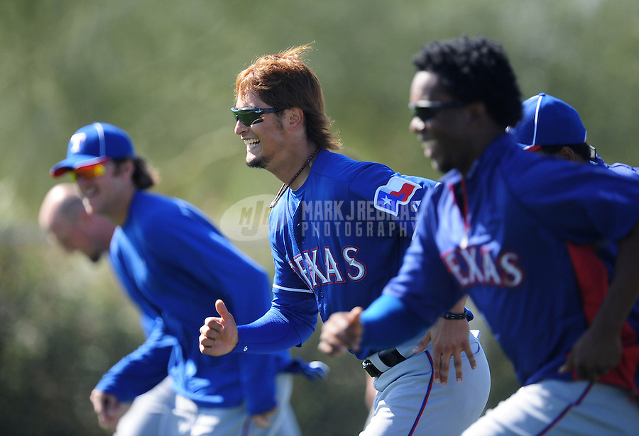 Mar. 1, 2012; Surprise, AZ, USA; Texas Rangers pitcher Yu Darvish (center) runs sprints with teammates during spring training workouts at the practice fields at Surprise Stadium.  Mandatory Credit: Mark J. Rebilas-.