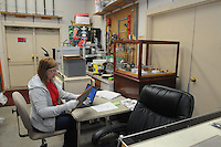 NWA Democrat-Gazette/FLIP PUTTHOFF <br /> Chris Rumohr (cq), a volunteer, does her job at a desk Tuesday Sept. 22 2015 in the work room at the Rogers Historical Museum because of a lack of office space at the museum.