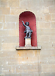 Small cupid statue in alcove of building, Bath