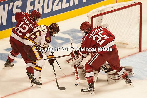 John Marino (Harvard - 12), Billy Exell (UMD - 16), Wiley Sherman (Harvard - 25) - The University of Minnesota Duluth Bulldogs defeated the Harvard University Crimson 2-1 in their Frozen Four semi-final on April 6, 2017, at the United Center in Chicago, Illinois.