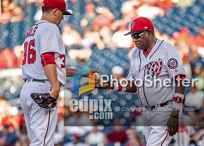 8 July 2017: Washington Nationals Manager Dusty Baker takes the ball and relieves pitcher Sammy Solis of his duties on the mound during a game against the Atlanta Braves at Nationals Park in Washington, DC. The Braves shut out the Nationals 13-0 to take the third game of their 4-game series. Mandatory Credit: Ed Wolfstein Photo *** RAW (NEF) Image File Available ***