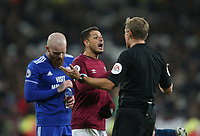 West Ham United's Javier Hernandez has words with referee Graham Scott<br /> <br /> Photographer Rob Newell/CameraSport<br /> <br /> The Premier League - West Ham United v Cardiff City - Tuesday 4th December 2018 - London Stadium - London<br /> <br /> World Copyright © 2018 CameraSport. All rights reserved. 43 Linden Ave. Countesthorpe. Leicester. England. LE8 5PG - Tel: +44 (0) 116 277 4147 - admin@camerasport.com - www.camerasport.com