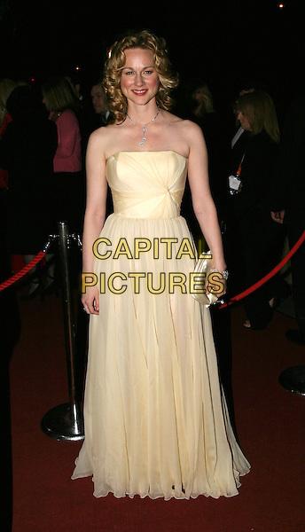 LAURA LINNEY.Bafta Awards - British Academy Awards.15 February 2004.full length, full-length, long yellow strapless dress.www.capitalpictures.com.sales@capitalpictures.com.© Capital Pictures.
