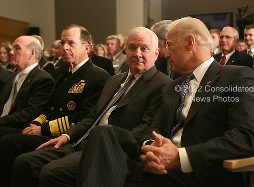 White House Chief of Staff William Daley,Chairman of the Joint Chiefs of Staff Mike Mullen, Secretary of Defense Bill gates and Vice President Joseph Biden watch President Barack Obama update the American people on the situation in Libya. President Obama is speaking at the National Defense University in Washington, DC on March 28, 2011.  .Credit: Dennis Brack / Pool via CNP