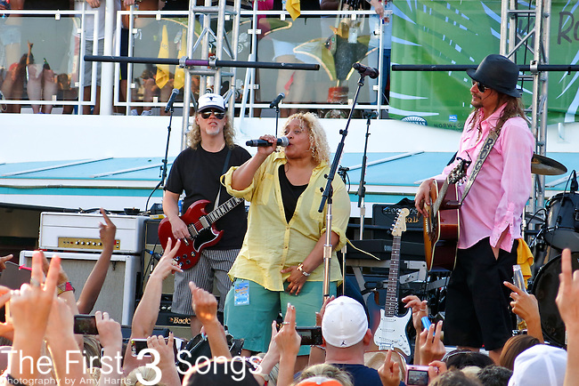 Stefanie Eulinberg of the Twisted Brown Trucker Bands sings with Kid Rock (Robert Ritchie) during the 2013 Kid Rock's 4th Annual Chillin' the Most Cruise. The cruise left Miami, Florida on March 6,  2013 sailing to Grand Stirrup Cay (Bahamas) and returned to Miami on March 10, 2013. The event, produced by Sixthman, featured performances by Kid Rock and other musical artists.