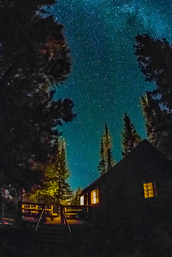At night view of one of the cabins at Trappers Lake Lodge with a starry sky above, near Trappers Lake, in the Flat Tops Wilderness, Colorado USA.