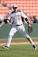 Matt Duffy #13 of the Tennessee Volunteers watches the completion of a play at first at Lindsey Nelson Stadium against the the Manhattan Jaspers on March 12, 2011 in Knoxville, Tennessee.  Tennessee won the first game of the double header 11-5.  Photo by Tony Farlow / Four Seam Images..