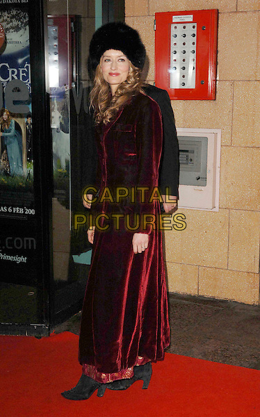 "NATASCHA McELHONE .At ""The Secret Of Moonacre"" UK Film Premiere, Vue West End, London, England, January 25th 2009..full length black fur Russian hat red coat Natasha  velvet long maxi .CAP/DS.©Dudley Smith/Capital Pictures"