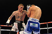 Lewis Ritson (white/black shorts) defeats Kristian Laight on points on his professional debut during a Boxing Show at the Metro Radio Arena on 4th April 2015