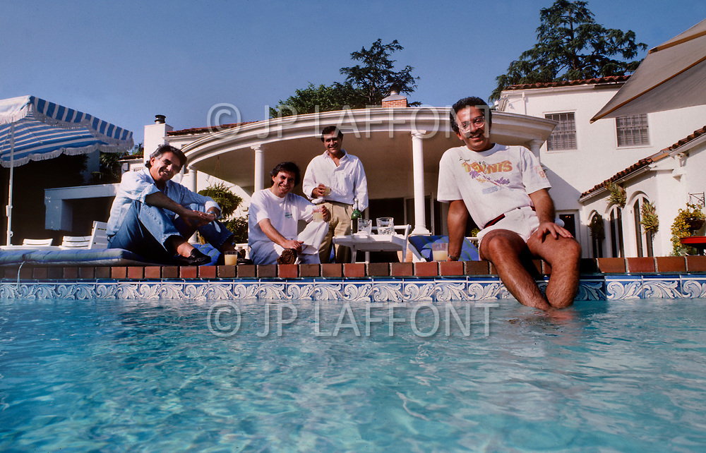 July, 1987, Los Angeles, California, USA - Guess Jeans designers The Marciano Brothers at home.