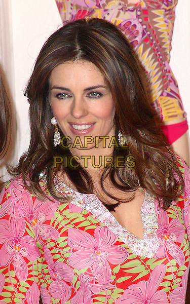 """ELIZABETH HURLEY .opens her first """"Elizabeth Hurley Beach Boutique"""" at the Bicester Village Luxury Outlet Centre, Bicester, Oxfordshire,.April 2nd 2009.liz portrait headshot pink print top tunic floral dangly earrings white beads .CAP/JIL.©Jill Mayhew/Capital Pictures"""