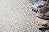 Laberinto, a stone hand-cut mosaic, shown in honed Calacatta and honed Jura Grey, is part of the Parterre Collection by Paul Schatz for New Ravenna.