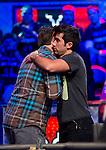 Jesse Sylvia hugs Robert Salaburu after eliminating him in 8th place..