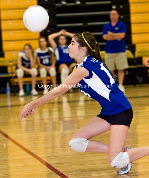 WATERBURY, CT - 09 NOVEMBER 2009 -110909JT13-<br /> Housatonic's Megan Fischer bumps the ball during Monday's game against Kaynor Tech at Kaynor.<br /> Josalee Thrift Republican-American
