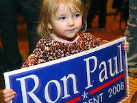 Alcyone Max, 2 years old, shows her support for Ron Paul during the Missoula County Republican caucuses, Tuesday, Feb. 5, 2007, in Missoula, Mont. (AP Photo/James Snook)