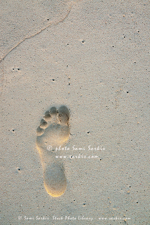 Footprint in sand on beach, close-up, Punta Cana, Dominican Republic
