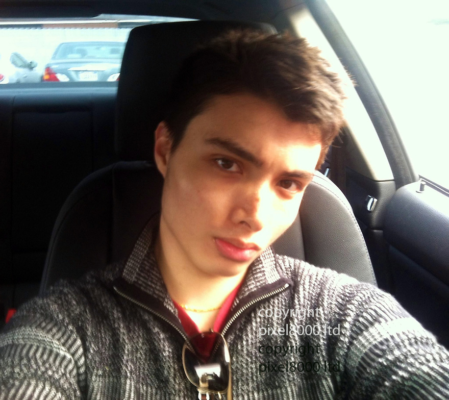 Pic shows: Elliot Rodger  - man allegedly involved in drive-by killings in Santa Barbara.<br /> <br /> Seen here in the black BMW he was found dead in.<br /> <br /> <br /> A gunman went on a drive-by shooting rampage in a Santa Barbara student enclave and at least seven people were killed, including the attacker, authorities said.<br /> Investigators believe a 22-year-old named Elliot Rodger driving a black BMW acted alone in the shootings around 9:30pm Friday night in Isla Vista near the University of California, Santa Barbara.<br /> Santa Barbara County Sheriff Bill Brown confirmed at a news conference early Saturday that that seven people were killed, including the gunman, and seven wounded.<br /> Rodger was the son of Peter Rodger, assistant director of the Hollywood film franchise The Hunger Games. An attorney for Peter Rodger has confirmed to KCAL that Elliot Rodger was 'involved' in the shooting.<br /> <br /> Selfie from open Facebook page of  Elliot Rodger<br /> <br /> <br /> <br /> <br /> <br /> Picture by Pixel8000 07917221968