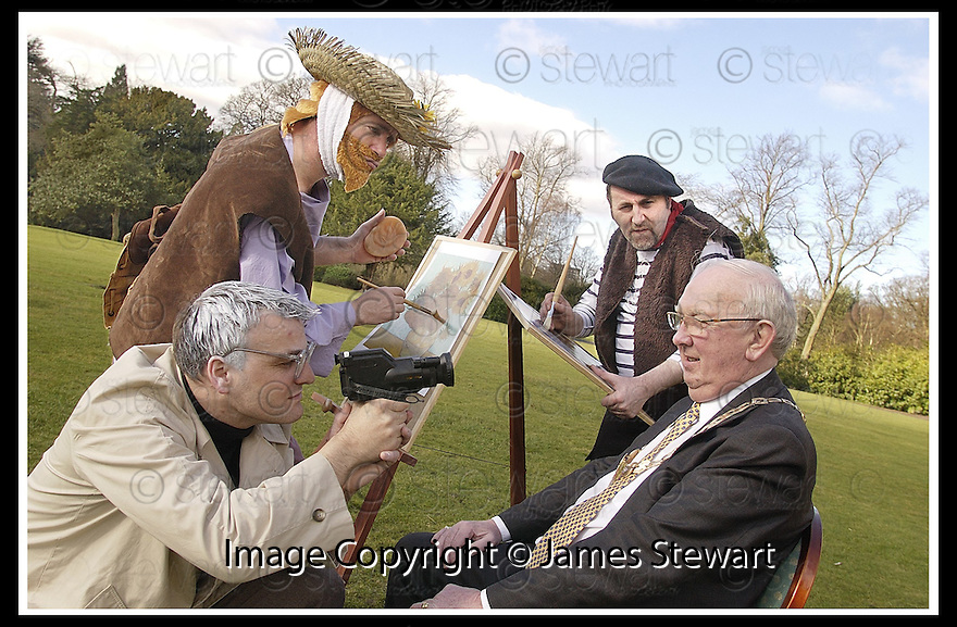 """12/03/2003                   Copyright Pic : James Stewart.File Name : stewart-big in falkirk 05.FALKIRK PROVOST JIM JOHNSTON RECEIVES THE ATTENTION OF STREET PERFORMERS ANDY WHARHOL (GLEN DICKSON), VAN GOGH ( ANDY TOWNSLEY) AND FRENCH IMPRESSIONIST PAINTER MATISE (MARTIN CAMPBELL), FROM THE INTERACTIVE PERFORMANCE COMPANY MISCHIEF LA BAS AS HE ANNOUNCES THE TOWN'S """"BIG IN FALKIRK"""" STREET ARTS FESTIVAL """"BIG IN FALKIRK""""..... .James Stewart Photo Agency, 19 Carronlea Drive, Falkirk. FK2 8DN      Vat Reg No. 607 6932 25.Office     : +44 (0)1324 570906     .Mobile  : +44 (0)7721 416997.Fax         :  +44 (0)1324 570906.E-mail  :  jim@jspa.co.uk.If you require further information then contact Jim Stewart on any of the numbers above........."""