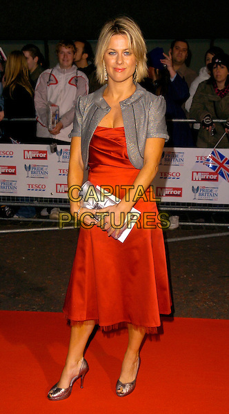 GEORGINA BOUZOVA.The Daily Mirror's Pride Of Britain Awards, London Television Studios, London, UK..November 6th, 2006.Ref: CAN.full length silver jacket clutch purse red dress.www.capitalpictures.com.sales@capitalpictures.com.©Can Nguyen/Capital Pictures
