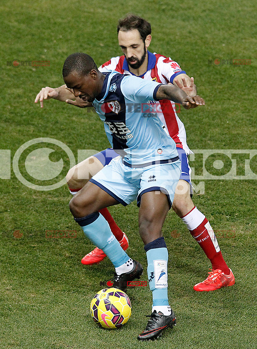 Atletico de Madrid's Juanfran Torres (r) and Rayo Vallecano's Gael Kakuta during La Liga match.January 24,2015. (ALTERPHOTOS/Acero) /NortePhoto<br />