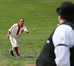Belleville Stags pitcher lobs the ball as he is watched by the arbiter, standing near home plate at their Saturday August 18 game under the Gateway Arch on the St. Louis riverfront.  The teams played by rules of the game as they were in the late 19th century -- when there were no umpires, only a lone arbiter to make judgement calls.  The Stags, Cyclones, and the Unions competed in a mini-tournament to build interest in vintage base ball leagues and were hosted on the site by the Federal Park Service, which had information booths and handouts for interested people.  About 150 people around the perimeter of the makeshift field watched all or part of the three games the teams played.