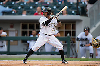 Leury Garcia (24) of the Charlotte Knights at bat against the Norfolk Tides at BB&T BallPark on April 9, 2015 in Charlotte, North Carolina.  The Knights defeated the Tides 6-3.   (Brian Westerholt/Four Seam Images)