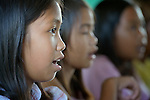 Children in class in Bacubac, a neighborhood in Basey in the Philippines province of Samar. The community was hit hard by Typhoon Haiyan in November 2013. The storm was known locally as Yolanda. The ACT Alliance has been providing a variety of forms of assistance to survivors here.