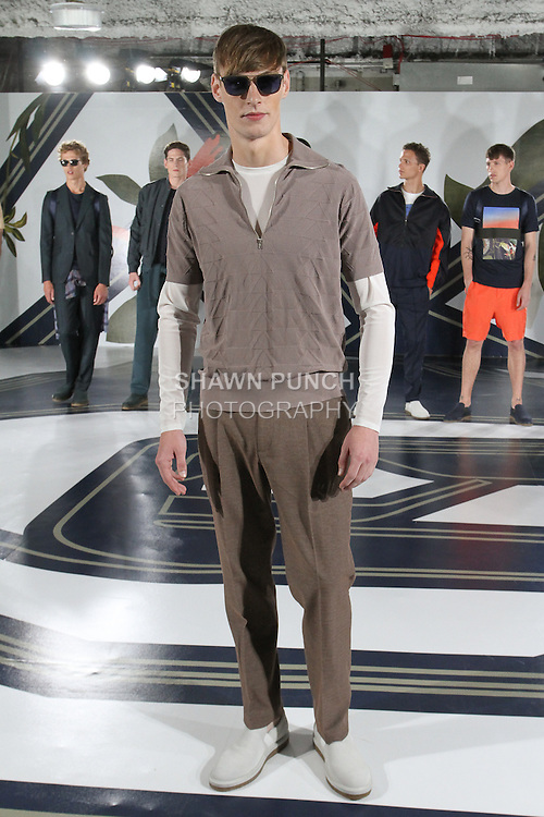 Model Roberto poses in a nylon track polo in quartz, mesh t-shirt in stone, and textured trousers in quartz, from the Perry Ellis Spring 2017 collection by Michael Maccari, on July 11th 2017, during New York Fashion Week Men's Spring Summer 2017.