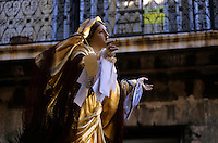Statue of the Virgin Mary bearing vows around her wrists during the feast of the Assumption of Mary.