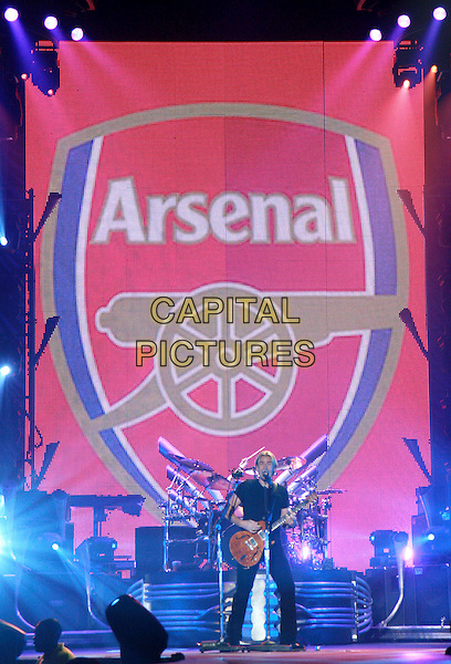 NICKELBACK  - Chad Kroeger.Perform live in concert at Wembley Arena, London, England, UK,.19th January 2010..music gig band tour on stage playing performing guitar group full length screen Arsenal fc football club logo.CAP/MAR.© Martin Harris/Capital Pictures.