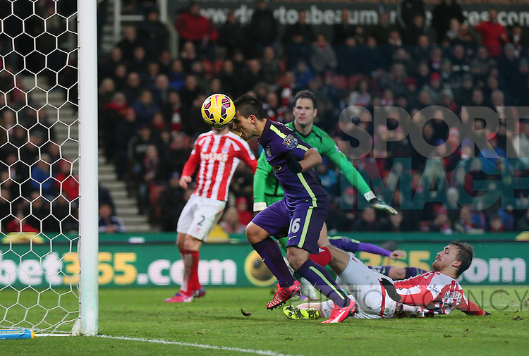 Sergio Aguero of Manchester City heads the ball into the net in first half extra time only for the referee to disallow the goal - Barclays Premier League - Stoke City vs Manchester City - Britannia Stadium - Stoke on Trent - England - 11th February 2015 - Picture Simon Bellis/Sportimage