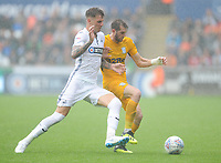 Preston North End's Tom Barkhuizen vies for possession with Swansea City's Joe Rodon<br /> <br /> Photographer Kevin Barnes/CameraSport<br /> <br /> The EFL Sky Bet Championship - Swansea City v Preston North End - Saturday August 11th 2018 - Liberty Stadium - Swansea<br /> <br /> World Copyright &copy; 2018 CameraSport. All rights reserved. 43 Linden Ave. Countesthorpe. Leicester. England. LE8 5PG - Tel: +44 (0) 116 277 4147 - admin@camerasport.com - www.camerasport.com