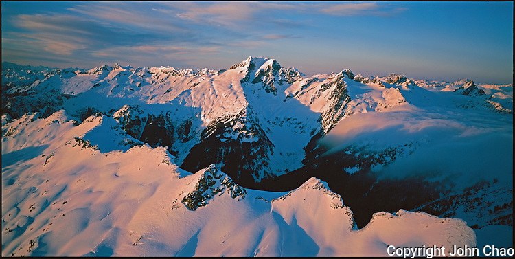 Sunset lighting on Spire and Dome Peaks, North Cascades Range, Washington State