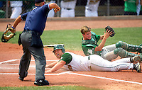 Dyersville Beckman's Travis Rahe is called out at home plate by umpire Scott Behn after Fort Dodge St. Edmond catcher Patrick Flattery made the tag in the Class 2A championship Saturday at Principal Park in Des Moines.