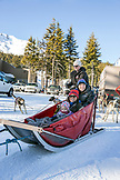 USA, Oregon, Bend, a family poses for a photo before heading out on their sled dog ride at Mt. Bachelor
