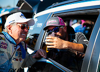 Oct 11, 2019; Concord, NC, USA; NHRA funny car driver Shawn Langdon (right) talks with John Force during qualifying for the Carolina Nationals at zMax Dragway. Mandatory Credit: Mark J. Rebilas-USA TODAY Sports
