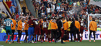 Calcio, Serie A: Lazio vs Roma. Roma, stadio Olimpico, 25 maggio 2015.<br /> Roma players, in background, celebrate at the end of the Italian Serie A football match between Lazio and Roma at Rome's Olympic stadium, 25 May 2015. Roma won 2-1.<br /> UPDATE IMAGES PRESS/Isabella Bonotto