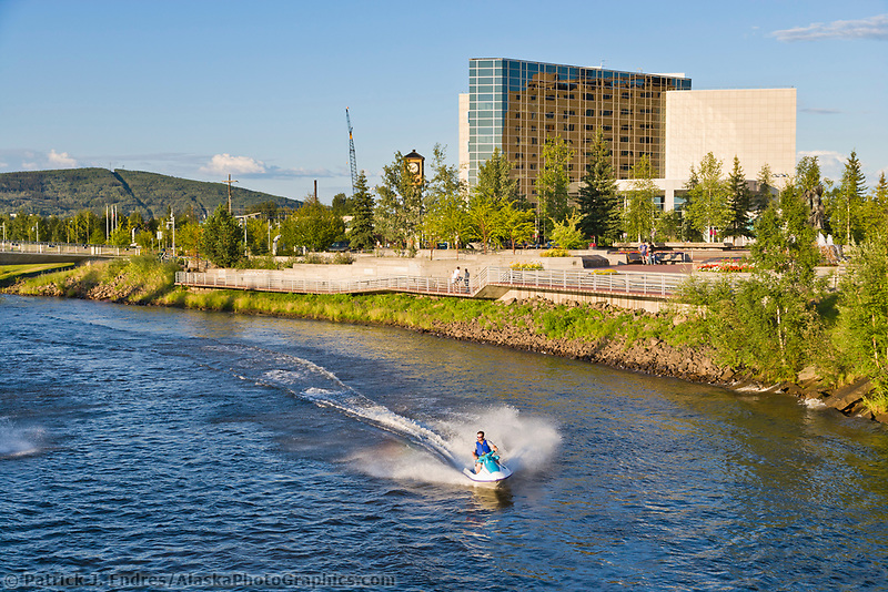 Jet skiers travel the Chena River in downtown Fairbanks, Alaska.