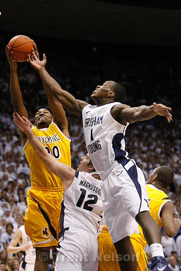 Trent Nelson  |  The Salt Lake Tribune.Wyoming's Brian Gibson pulls down a rebound ahead of BYU's Logan Magnusson, bottom, and BYU's Charles Abouo as BYU hosts Wyoming, college basketball in Provo, Utah, Saturday, March 5, 2011.
