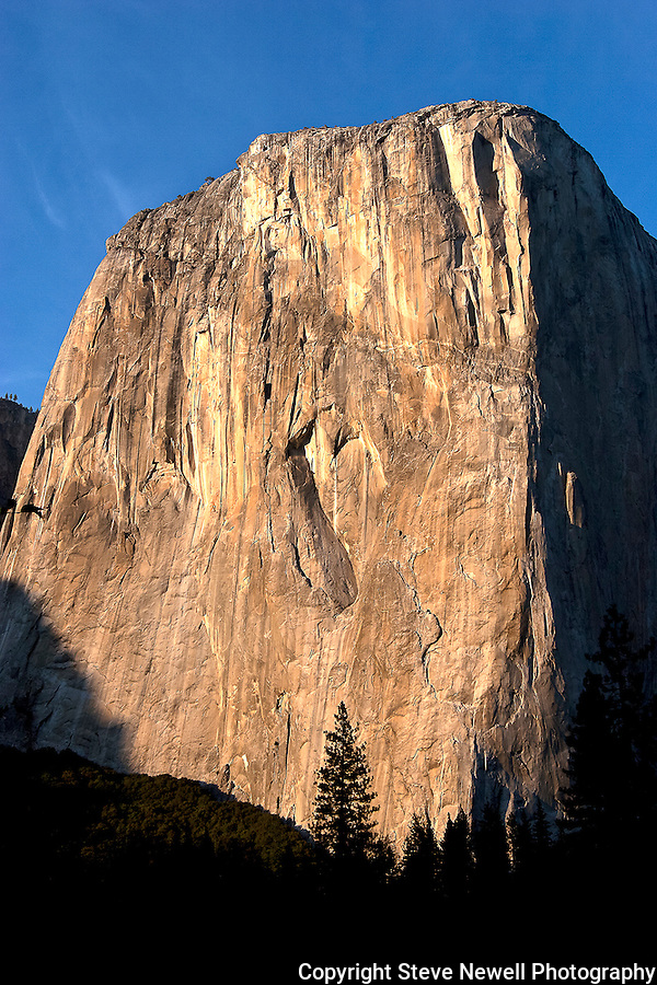 """The Capitan's Heart"" El Capitan, Yosemite NP At certain times of the day the sunlight allows you to see the Heart shaped natural rock carving on El Capitan located in Yosemite National Park. This Incredible monolith changes colors drastically at sunsets. Rock climbers climb up the shear overhanging granite by the thousands every year. I have climbed all of the big walls in Yosemite including El Capitan four times.  Yosemite Valley is a very special place in the world and is a must visit destination for all."