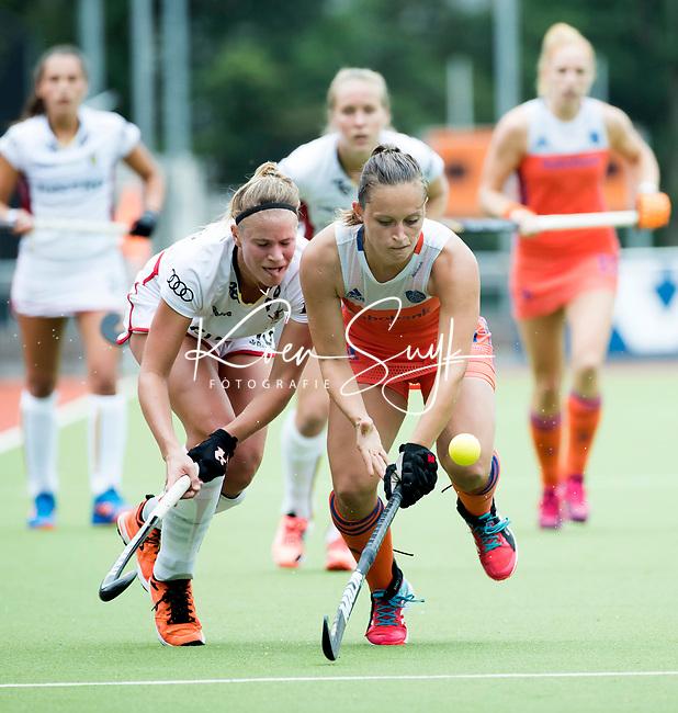 SCHIEDAM - Kelly Jonker (Ned) met Alix GERNIERS (Bel)   tijdens een oefenwedstrijd tussen  de dames van Nederland en Belgie , in aanloop naar het  EK Hockey, eind augustus in Amstelveen. COPYRIGHT KOEN SUYK