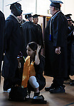 Ana Troya of Enfield but who relocated three years ago from Ecuador, does some last moment preparations, Friday, June 3, 2011, prior to graduation at Asnuntuck Community College, this is a big week for Troya six days ago she gave birth to a baby boy. (Jim Michaud/Journal Inquirer)