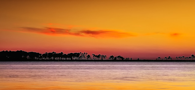 Orange sunset over Gulf of Mexico in Apalachicola, Florida