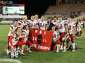 Manatee Hurricanes players including Derrick Calloway #57, Richard Baird #54, Kyle Mauk #72, Robert Morgan #73, Shawn Wilkes #67, Michael Galati #82, and Dylan Beauchamp #68 pose for a photo after the Championship trophy after the Florida High School Athletic Association 7A Championship Game at Florida's Citrus Bowl on December 16, 2011 in Orlando, Florida.  Manatee defeated First Coast 40-0.  (Photo By Mike Janes Photography)