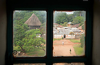 Small window within the grounds of the Fons (local tribal leader) Palace, Bafut, Cameroon