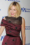 BEVERLY HILLS, CA- OCTOBER 23: Actress Sienna Miller arrives at the International Medical Corps' Annual Awards dinner ceremony at the Beverly Wilshire Four Seasons Hotel on October 23, 2014 in Beverly Hills, California.