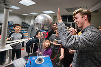 Randall Niffenegger, a senior physics major from Waldo, Wisconsin, demonstrates static electricity charge during Science Night at the Museum, one of many Darwin Week events taking place through Saturday. <br />
