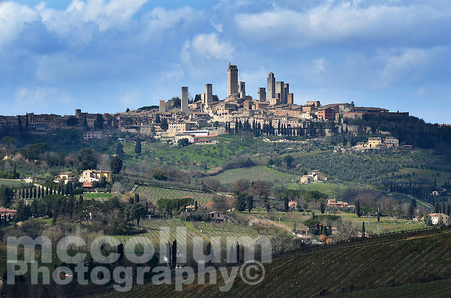 Michael McCollum.3/15/13.Storm clouds pass over the countryside and the town of San Gimignano, Tuscany, Italy.
