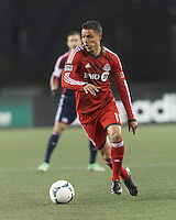 Toronto FC forward Luis Silva (11) on the attack.  In a Major League Soccer (MLS) match, the New England Revolution (blue) defeated Toronto FC (red), 2-0, at Gillette Stadium on May 25, 2013.