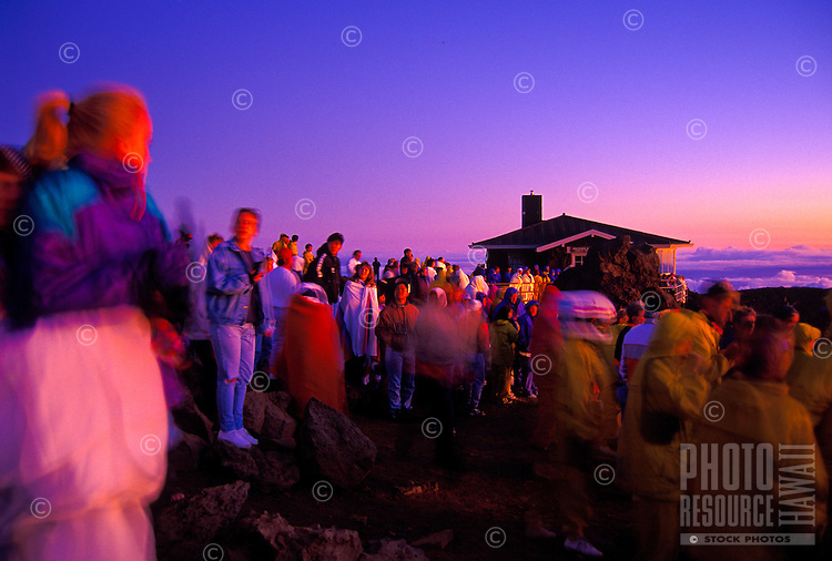 A large group of people enjoy the view of a Haleakala sunrise